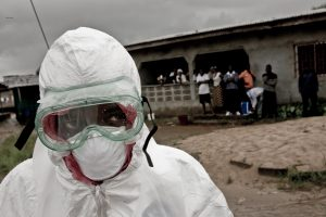 EBOLA, THIRD MILLENNIUM PLAGUE. The new principles that regulate social relations in Monrovia are simple: if you touch the wrong person, you die. Touch the person who has touched the wrong person, you die. Get on the wrong taxi, you die. You distractingly 1